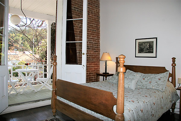 amador wine country hotel & restaurant - guestroom with bed and outside deck