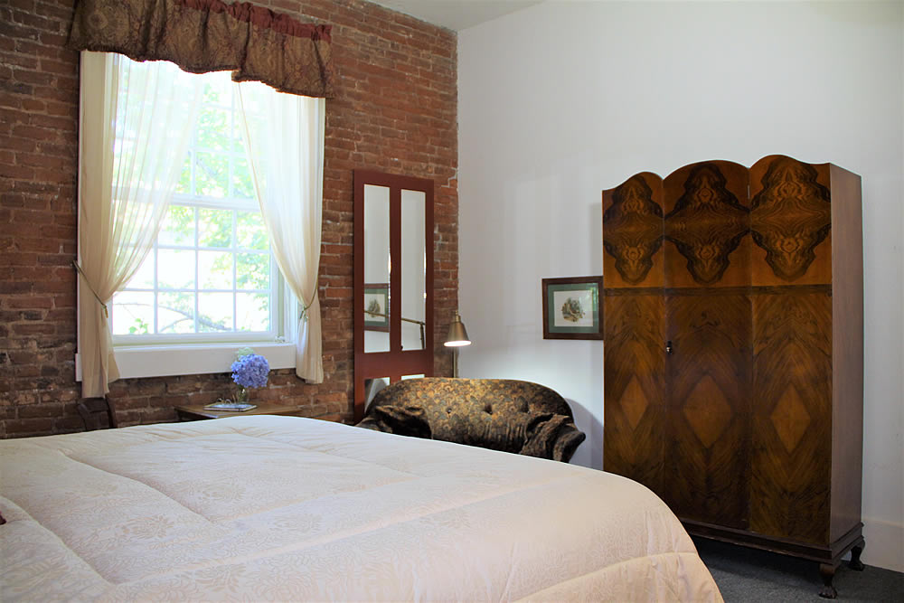 Amador Hotel Guest Room with bed and couch with closet